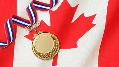 gold medal on Canadian flag.jpg